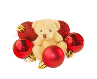 Teddy bear with five red Christmas balls on white. Stock Photos