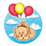 Teddy bear flies on balloons Stock Images