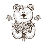Teddy bear with flowers. Stock Images