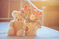 Teddy bear and flowers in the pot Royalty Free Stock Photos