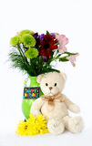 Teddy bear and flowers Royalty Free Stock Image