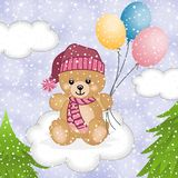 Teddy bear flying balloons in snow Royalty Free Stock Image