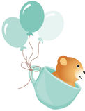 Teddy bear flying in blue cup with balloons Royalty Free Stock Photo