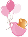 Teddy bear flying in pink cup with balloons Royalty Free Stock Image