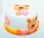 Teddy bear fondant cake. Girls birthday cake with a fondant teddy bear stock image