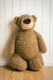 Teddy bear in front of  old wooden wall Stock Photos