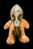 Teddy bear in a gas mask. Isolated against black Stock Image