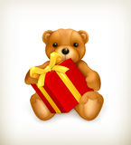 Teddy bear with gift Stock Images