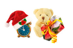 Teddy bear, gift, alarm clock with Santa hat on white. Stock Photo
