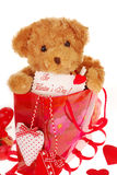 Teddy bear in gift bag for valentine Royalty Free Stock Photography