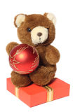 Teddy bear on gift box Royalty Free Stock Images