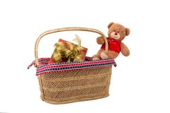 Teddy bear with gift box in basket. Teddy bear with red gift box in wicker basket Stock Photography