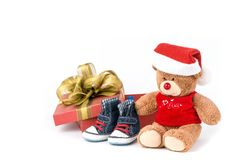 Teddy bear with gift box. Teddy bear with red gift box and blue jean shoes Royalty Free Stock Photography