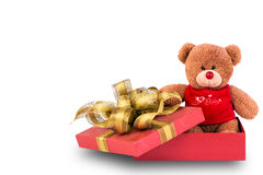 Teddy bear in gift box. Teddy bear in red gift box with golden ribbon Royalty Free Stock Photography