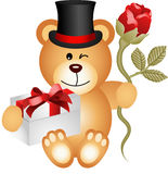 Teddy bear with gift box and red rose Stock Photo