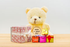 Teddy bear and gift box set. Teddy bear sitting on wooden table with gift box set for special day Stock Photography