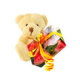 Teddy bear with gift isolated over white. Royalty Free Stock Images