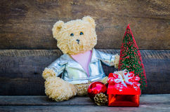 Teddy bear and gift on wooden background Stock Photo