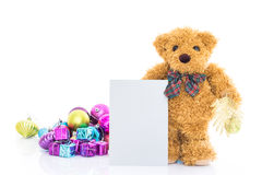 Teddy bear with gifts and blank greeting card Stock Images