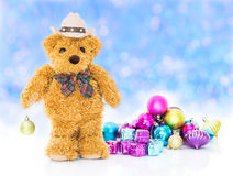 Teddy bear with gifts and ornaments new year Stock Photos