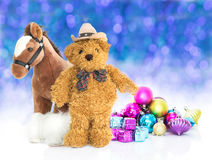 Teddy bear with gifts and ornaments new year Royalty Free Stock Images