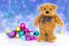 Teddy bear with gifts and ornaments new year Stock Image