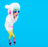 Teddy bear girl on a blue background. Crazy DJ and club winter p Stock Photo
