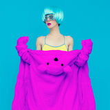 Teddy bear girl on a blue background. Crazy winter party. Club d Royalty Free Stock Image