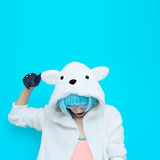 Teddy bear girl on a blue background. Crazy winter party. Club d Royalty Free Stock Photos