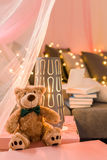 Teddy bear in girl's room Royalty Free Stock Images