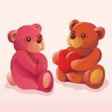 Teddy bear giving his heart away. A brown teddy bear expresses his love to a pink teddybear by giving his heart away Royalty Free Stock Photos