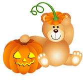 Teddy bear with halloween pumpkin Royalty Free Stock Image