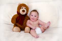 Teddy bear and happy baby boy stock photos