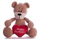 Teddy bear and happy birthday heart pillow. Teddy bear with happy birthday heart pillow Royalty Free Stock Photo