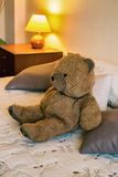 Teddy bear. Happy teddy bear relaxing on comfortable bed Royalty Free Stock Photos