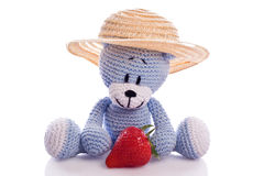 Teddy bear with hat and fresh strawberries Stock Photo
