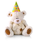 Teddy bear in a hat with the inscription Stock Photo