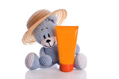 Teddy bear with hat and suncream lotion Royalty Free Stock Photo