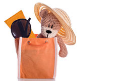 Teddy bear with hat suncream and sunglasses Stock Photos