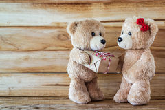 Teddy bear have a gift to girl friend Stock Photo