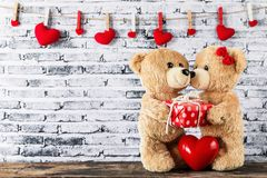 Teddy bear have a gift to girl friend Stock Photography