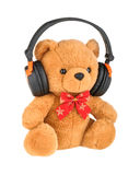 Teddy bear with headphones isolated on white Stock Image