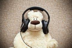 Teddy bear with headphones Stock Photo