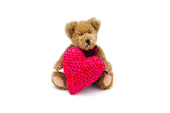 Teddy bear with a heart. Teddy bear with a heart on white background Stock Photo