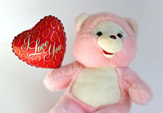 Teddy bear with heart balloon Stock Photo