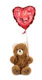 Teddy bear with heart balloon Stock Image