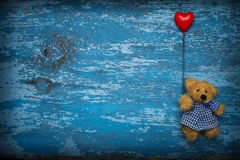 Teddy bear with heart baloon Stock Photos