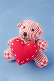 Teddy bear with a heart in his hands Stock Photos