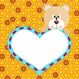 Teddy bear with heart on honeycomb background Royalty Free Stock Photos