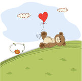 Teddy bear with heart on meadow Royalty Free Stock Image